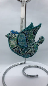 The striking blue and green fabric matched with plain coloured fabric on the breast and inside wings makes this stunning little lavender filled bird.  They measure 13cm and will be delivered in a gift box handmade especially for these birds.