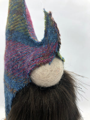 Hand made in the UK by Rose-May made with a brown beard for a younger look, this gnome has a hat made from Harris tweed matched with a felted wool green body. Gnomes and gonks are traditionally known for bringing good luck.