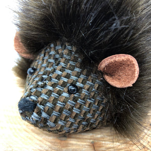 Handmade by Rose-May in Yorkshire you can buy these hedgehog gifts direct from the maker. Made with a lovely glossy and soft dark brown fur teamed with a woven fabric for the face and underbody. These hedgehogs are perfect gifts for hedgehog lovers. The ears are light brown leather teamed with black eyes and a hand embroidered nose.