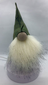 Gonk made with the Abraham Moon tweed green hat and pure wool fabric body this gnome is finished with a luxuriously soft full faux fur beard, his large felted wool nose adds to the character. Hand made in Britain by Rose-May in Helmsley, North Yorkshire.