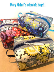 Cosmetic pouches by Mary Mulari