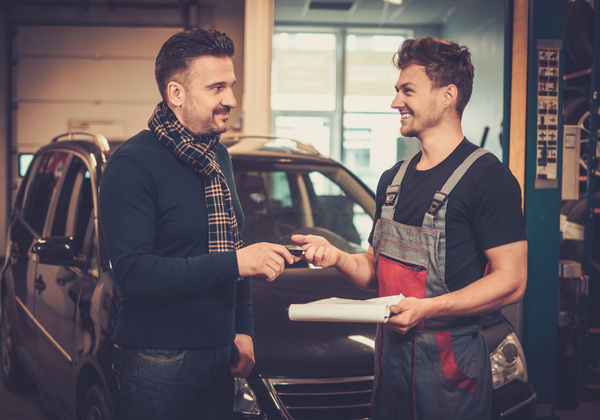 Auto Mechanic With Satisfied Client