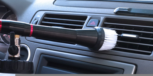 Dashboard And Center Console Detailing Vents Using Car Cleaning Gun