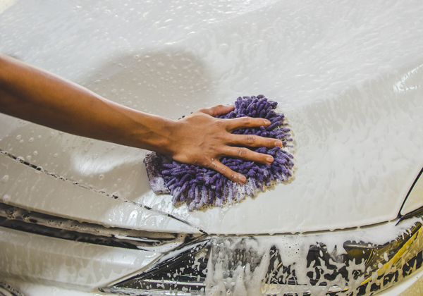 Touchless Car Washes    Will a touchless car wash damage your car's paint? Is it better than an automatic car wash with rotating brushes?   In this post you'll know:   How a touchless car wash works  If it's better or worse than an automatic car wash with rotating brushes  If it's safe for your car  If it's better or worse than traditional hand wash  By the end of this blog, you'll know the pros and cons of a touchless car wash and you'll be able to decide which car wash option to go for.   Let's get started.  How A Touchless Car Wash Works   A touchless car wash is a car wash method using high-pressure water jets to remove contaminants from the car. Its 3 washing components are:    Water  Cleaning agent  Water pressure It's still automated, but unlike most tunnel washes, it doesn't use rotating brushes. The high-pressure water jets work in place of the brushes to lift the dirt off the car.   touchless car wash   Because a touchless car wash eliminates the need for physical touches that causes scratches, some feel it's safer for your paint.    There is some level of truth to this. But its main cleaning component that supposedly lessens scratch causes will contribute to these damages.   I'll tell you why in a bit.   Touchless Car Wash Is Better Than An Automatic Car Wash With Rotating Brushes  There is no doubt, friction washes mar the car's paintwork. This is definitely the case with this type of car wash.   In an automatic wash, also called a tunnel wash, the rotating brush or bristle picks up all the dirt from previous cars it cleaned.    With all the dirt and dust it accumulated, the brushes turn into something like soapy sandpaper.   touchless car wash vs tunnel car wash   Imagine all those filthy grit slapped into your precious car's finish over and over again!  That's going to hurt a lot.  Even if it's fast and convenient, an automatic wash like this is something you should avoid if you want to preserve your paintwork's pristine life.   touchless car wash vs t