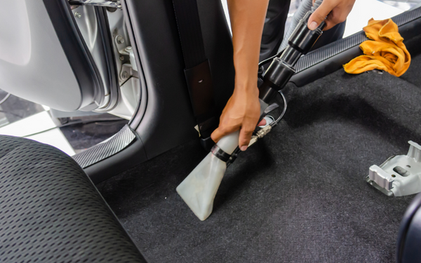 vacuuming for car carpet spot cleaning