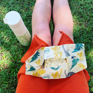 Kate Hall (Ethically Kate) Sits at the Beach with a Honeywrap from Be Vibrant