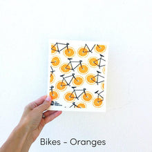 SPRUCE. A super star eco friendly dishcloth doing good things for the planet. In Bikes - Oranges Design.