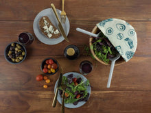 Honeywrap - Reusable Food Wrap. Picnic Design Wrapping a Bowl of Food.