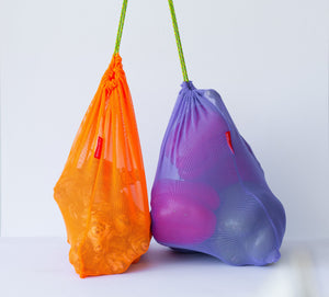 Goodie Bag in bright orange and purple with produce