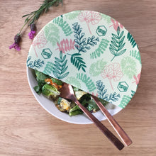 Honeywrap - Reusable Food Wrap. Botanical Design Wrapping a Bowl of Food.