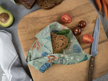 Honeywrap - Reusable Food Wrap. Ocean Design Wrapping a Sandwich.