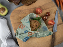 Honeywrap - Reusable Food Wrap. Ocean Covering Sandwich