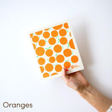 SPRUCE. A super star eco friendly dishcloth doing good things for the planet. In Oranges Design.