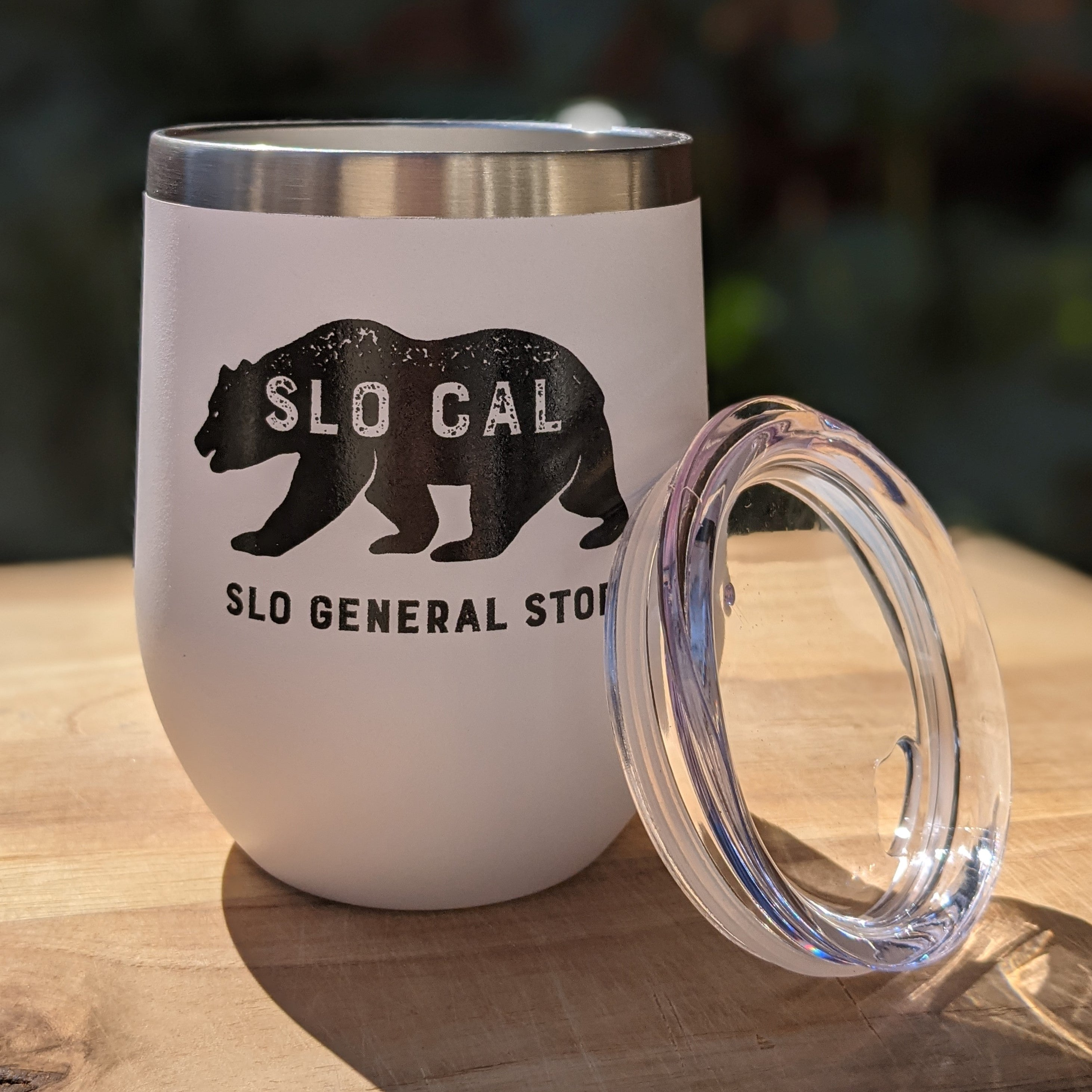 "white wine tumbler with clear lid and black logo and ""SLO CAL"" and ""SLO GENERAL STORE"""