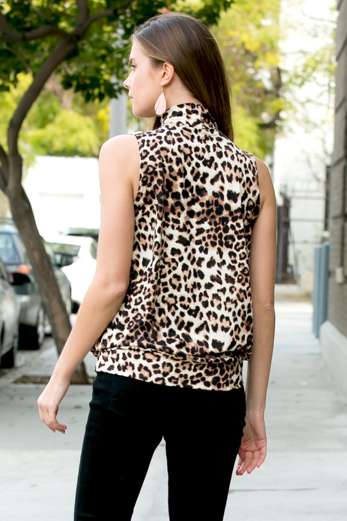 2a0dcf5bd1ddc Animal Print Mock Neck Sleeveless Pleated Top – Riah Fashion