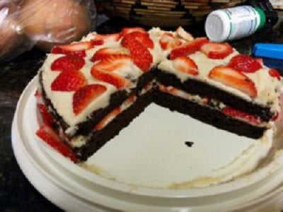 Chocolate cake with coconut cream icing and strawberries.