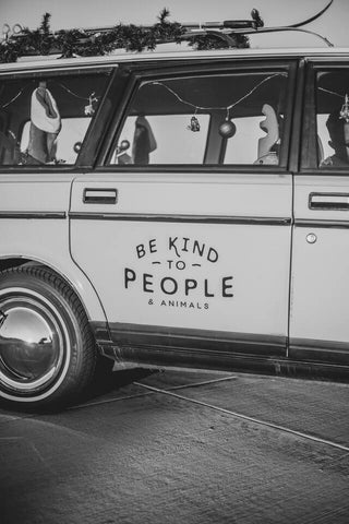 "The power of words + Kindness + JWLRY + Old school car pictured from the side with quote on the back door ""Be kind to people and animals""."