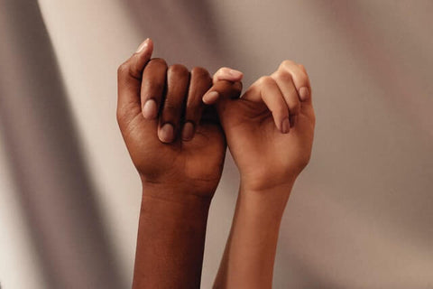 5 Easy tips for a fuller life + Compliment + JWLRY + light and dark skinned persons giving each other a pinky swear.