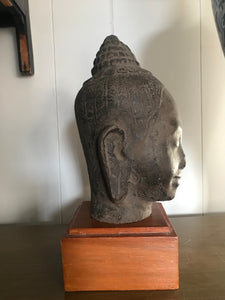 Early 20th c. Cambodian Head Of Buddha with wooden base. - The Sweetwood Collection