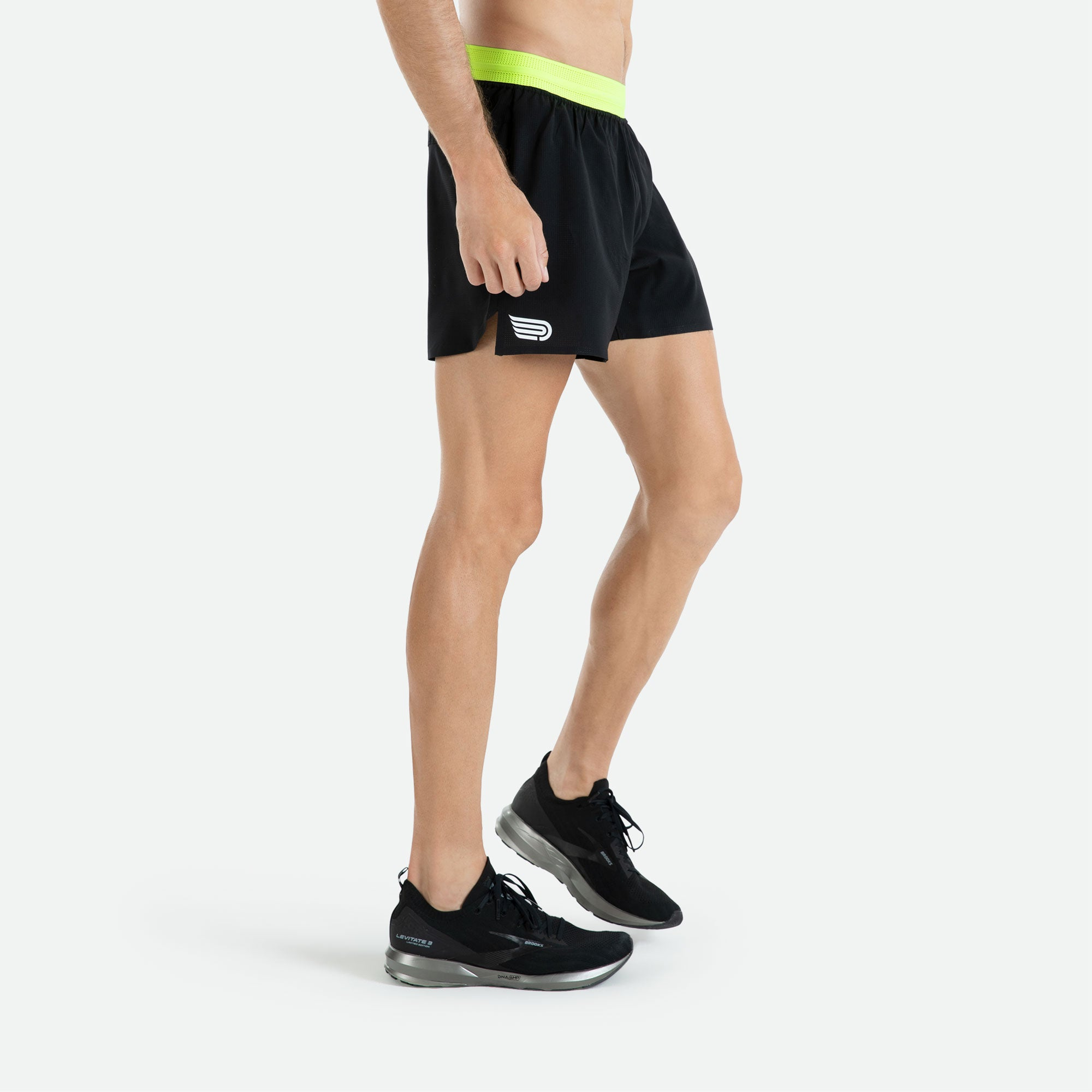 Italian Framis bonded hems and side seams with our Pressio men's black Ārahi 4.5'' run short for low profile lightweight performance.