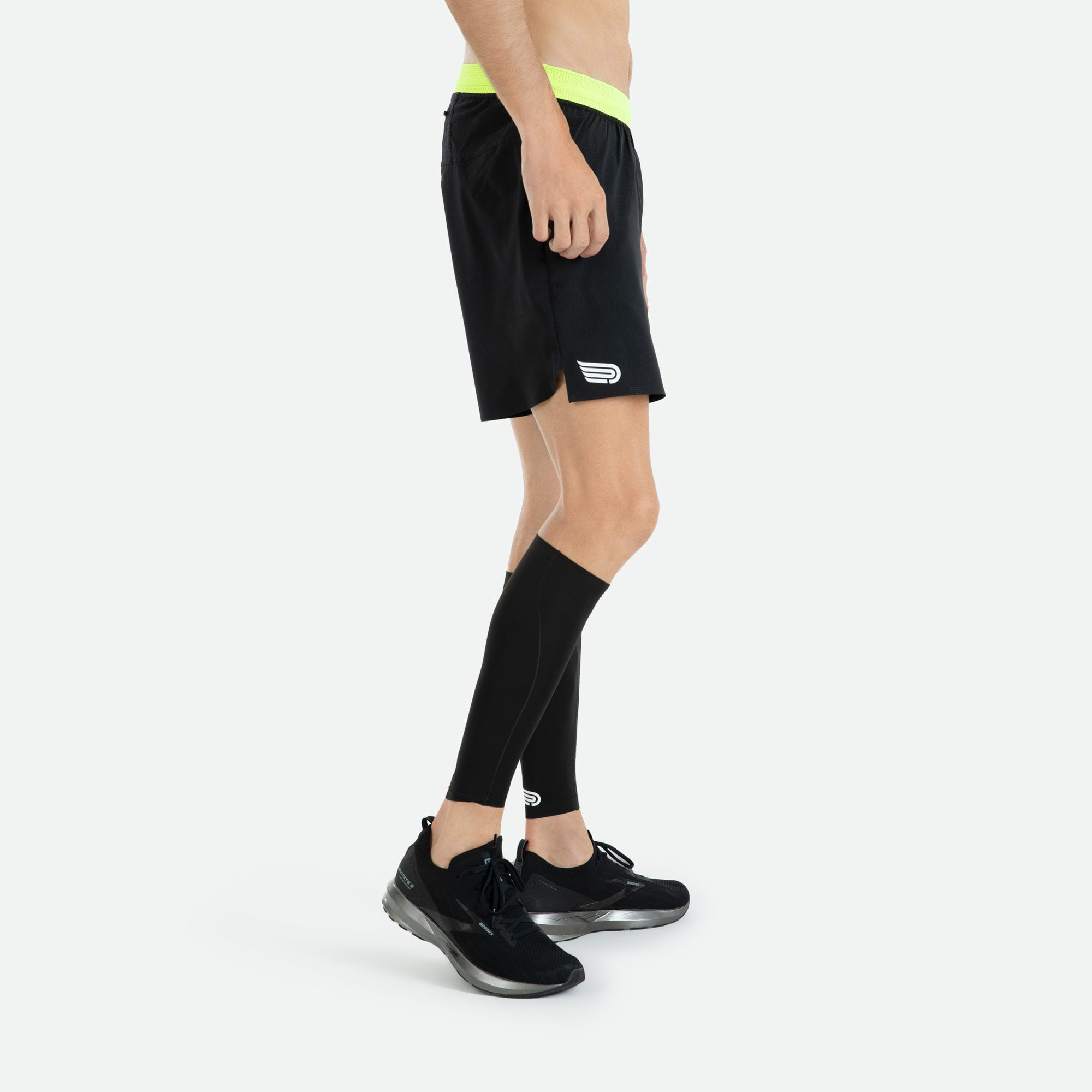 Italian Framis bonded hems and side seams with our Pressio men's black Ārahi 6.5'' run short for low profile lightweight performance.