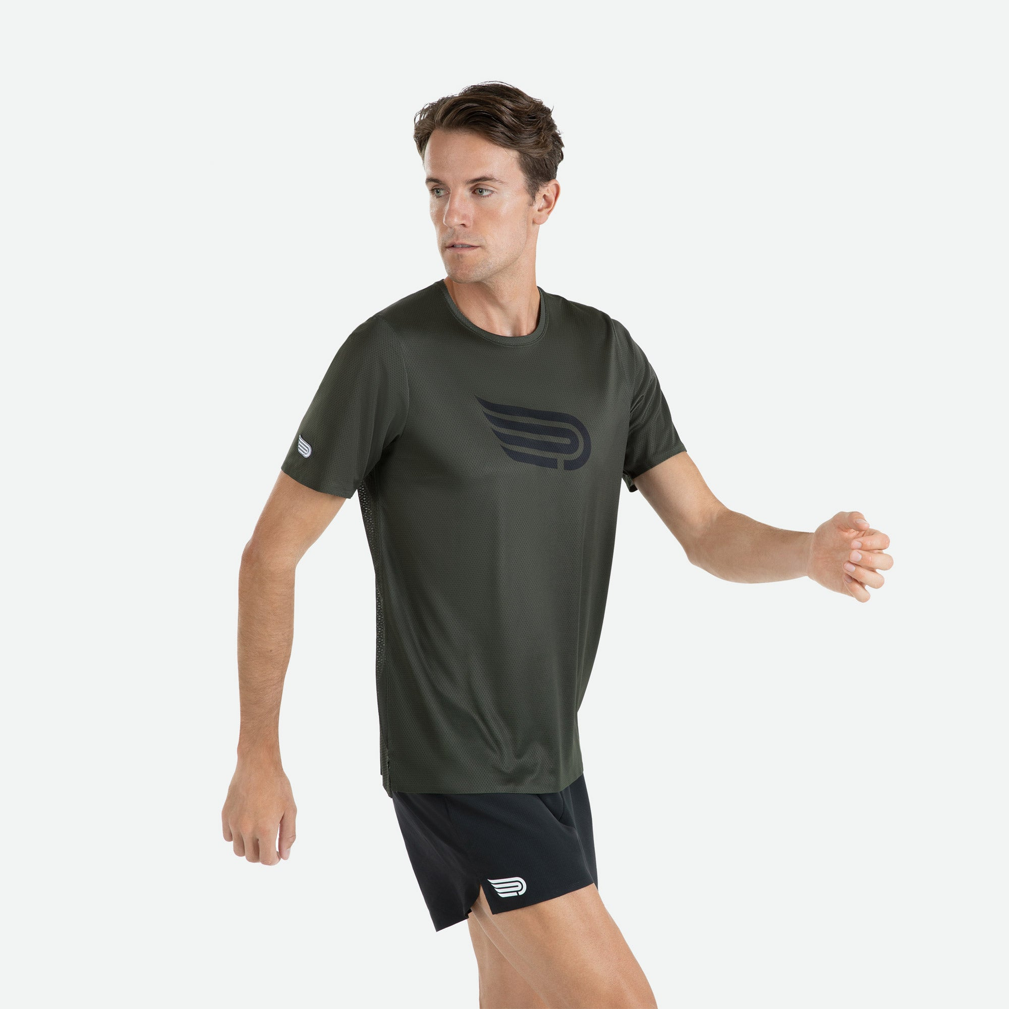 Engineered 3D vent mesh structure for optimal ventilation on the back of our Pressio men's Ārahi dark green/black short sleeve t-shirt.