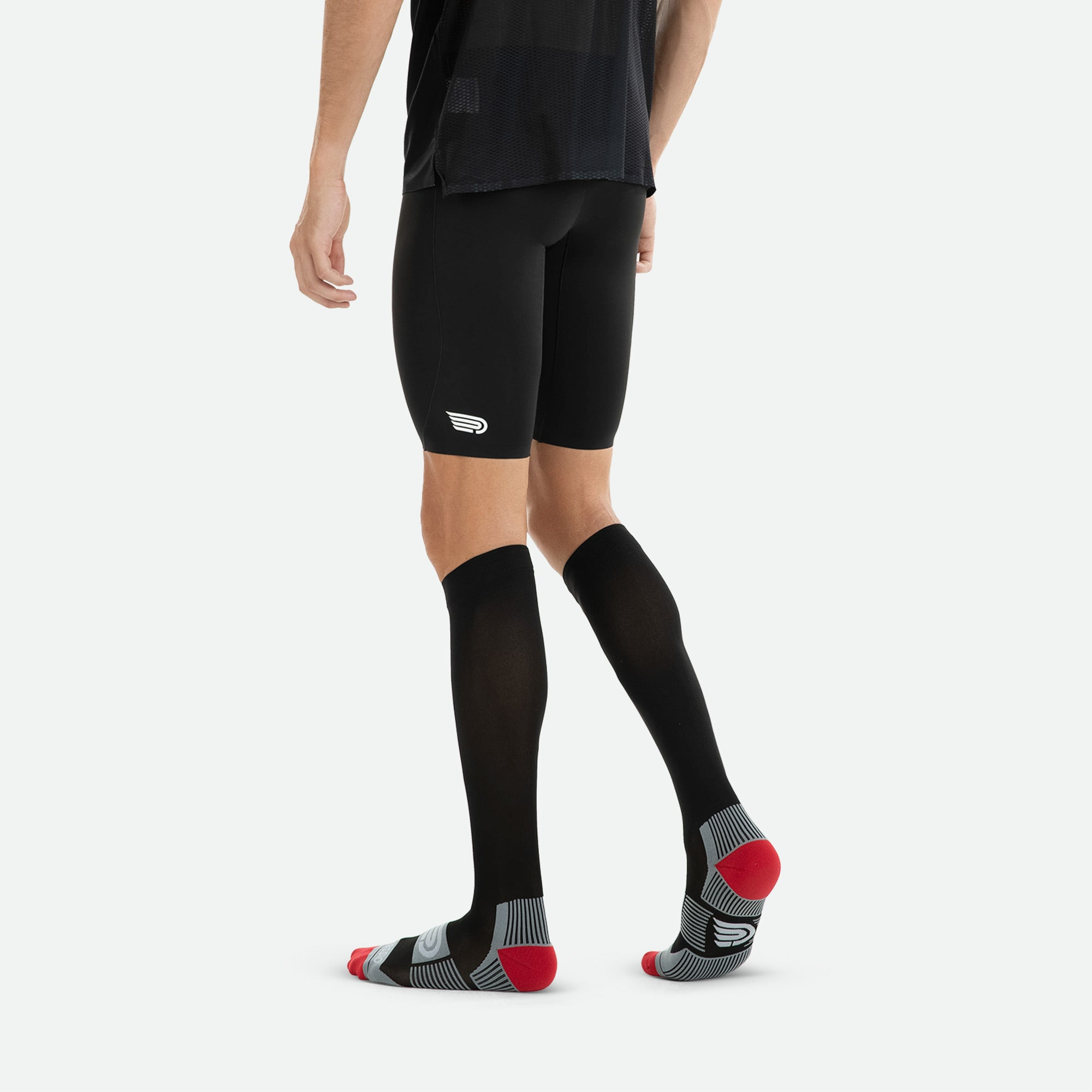 Pressio everyday unisex black compression sock knitted in Italy at a world-leading certified compression mill.