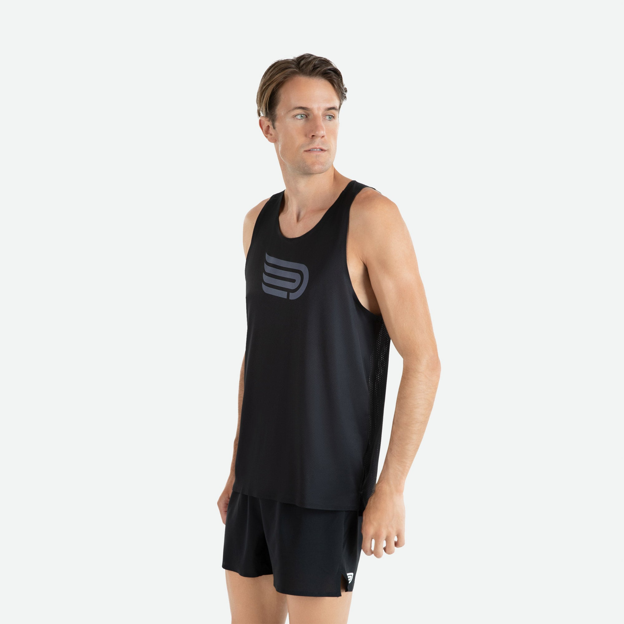 Our Pressio men's Ārahi black/dark grey singlet features EcoTECH MF fabric which has dual filament recycled polyester yarns from Unifi for superior moisture control to keep you dry.