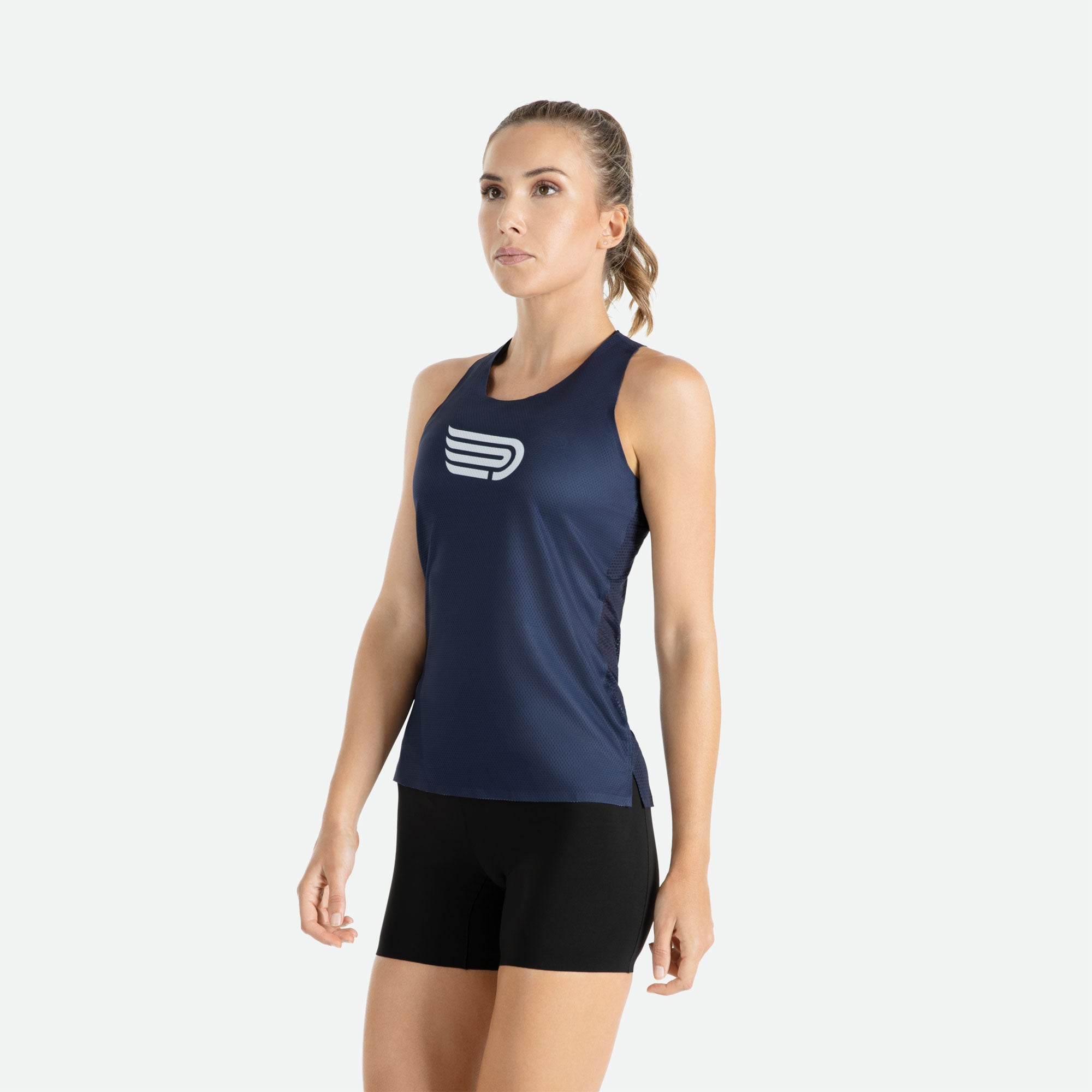 Our Pressio women's Ārahi navy/white singlet features EcoTECH MF fabric which has dual filament recycled polyester yarns from Unifi for superior moisture control to keep you dry.