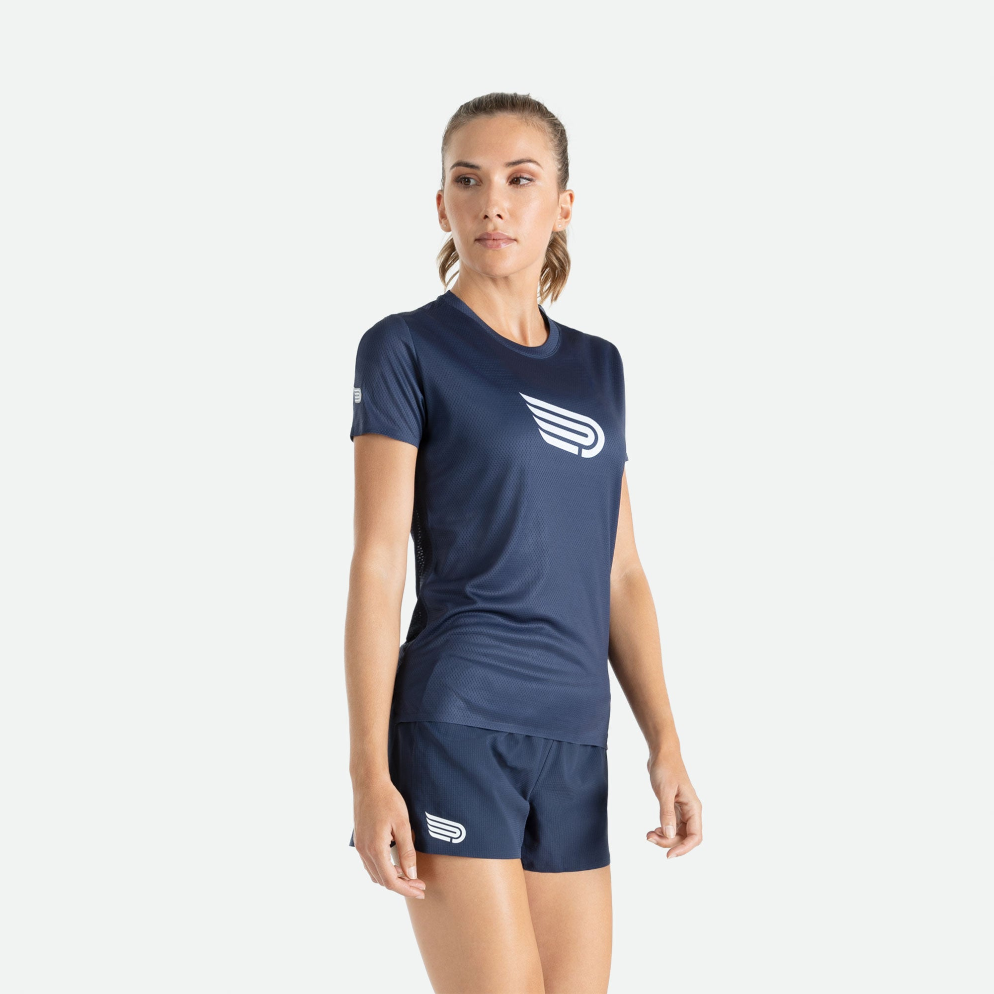 Our Pressio women's Ārahi navy/white short sleeve t-shirt features EcoTECH MF fabric which has dual filament recycled polyester yarns from Unifi for superior moisture control to keep you dry.