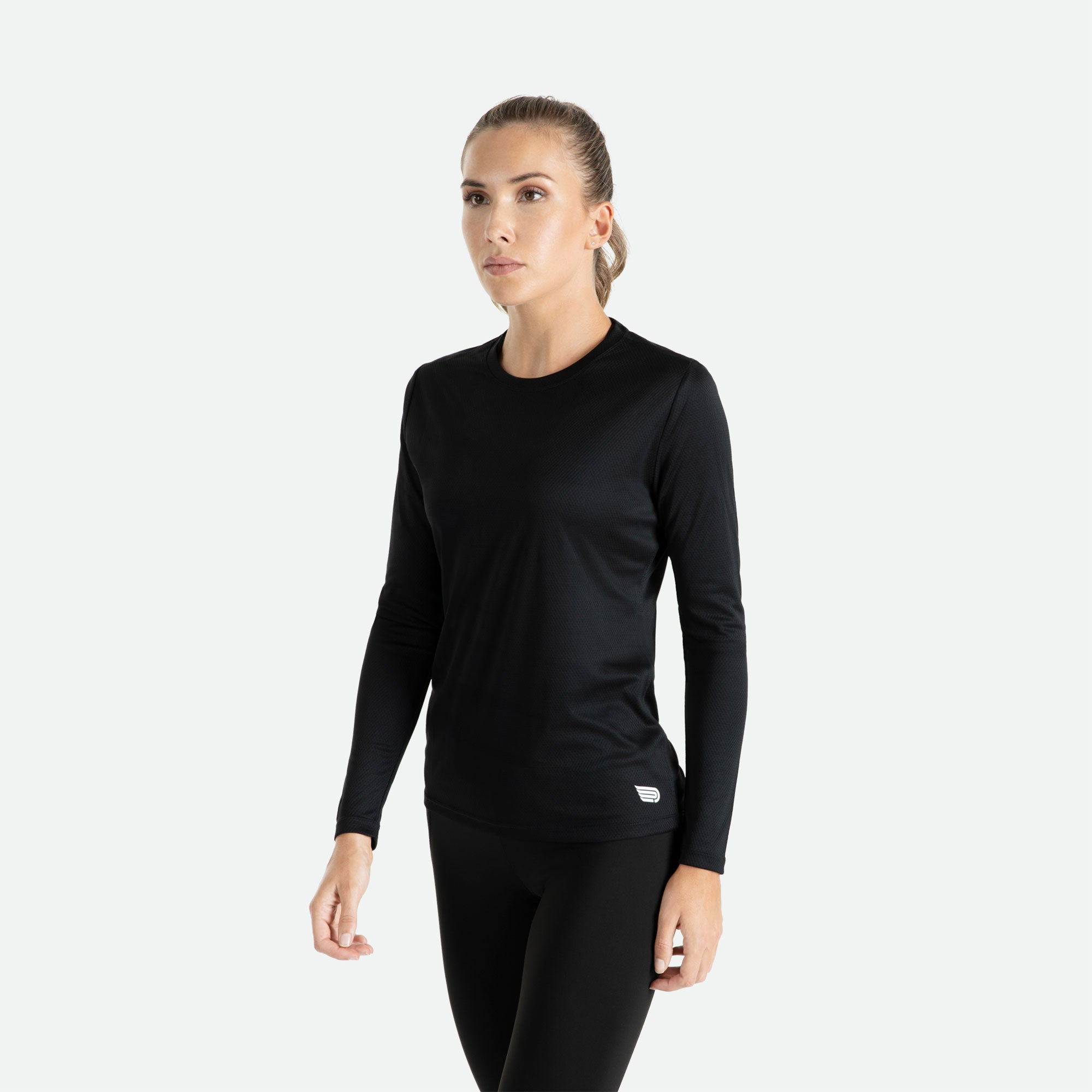 Our Pressio women's black Hāpai long sleeve t-shirt features EcoTECH MF fabric which has dual filament recycled polyester yarns from Unifi for superior moisture control to keep you dry.