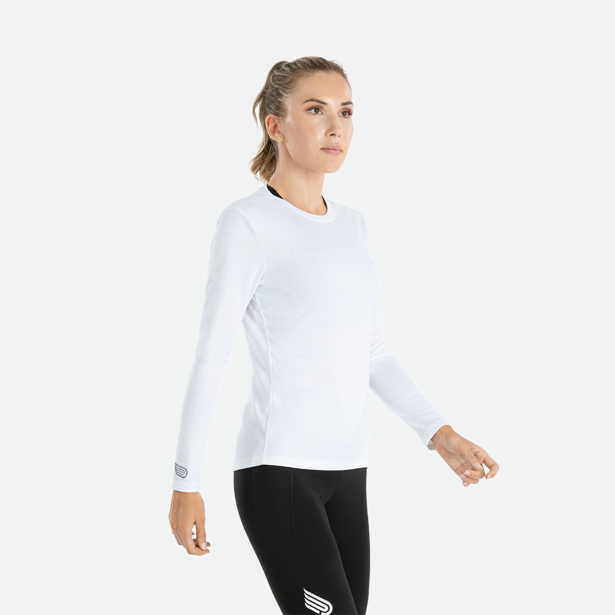 Our Pressio women's white Hāpai long sleeve t-shirt features EcoTECH MF fabric which has dual filament recycled polyester yarns from Unifi for superior moisture control to keep you dry.