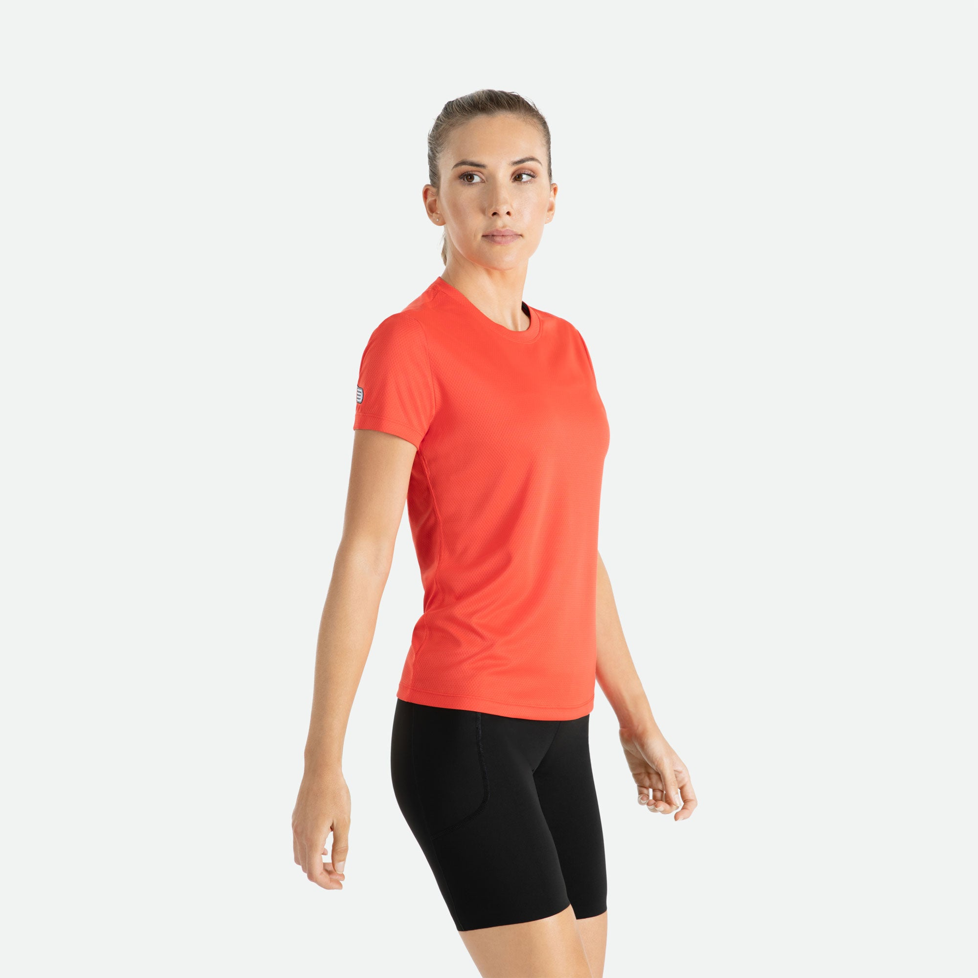 Our Pressio women's red Hāpai short sleeve t-shirt features EcoTECH MF fabric which has dual filament recycled polyester yarns from Unifi for superior moisture control to keep you dry.