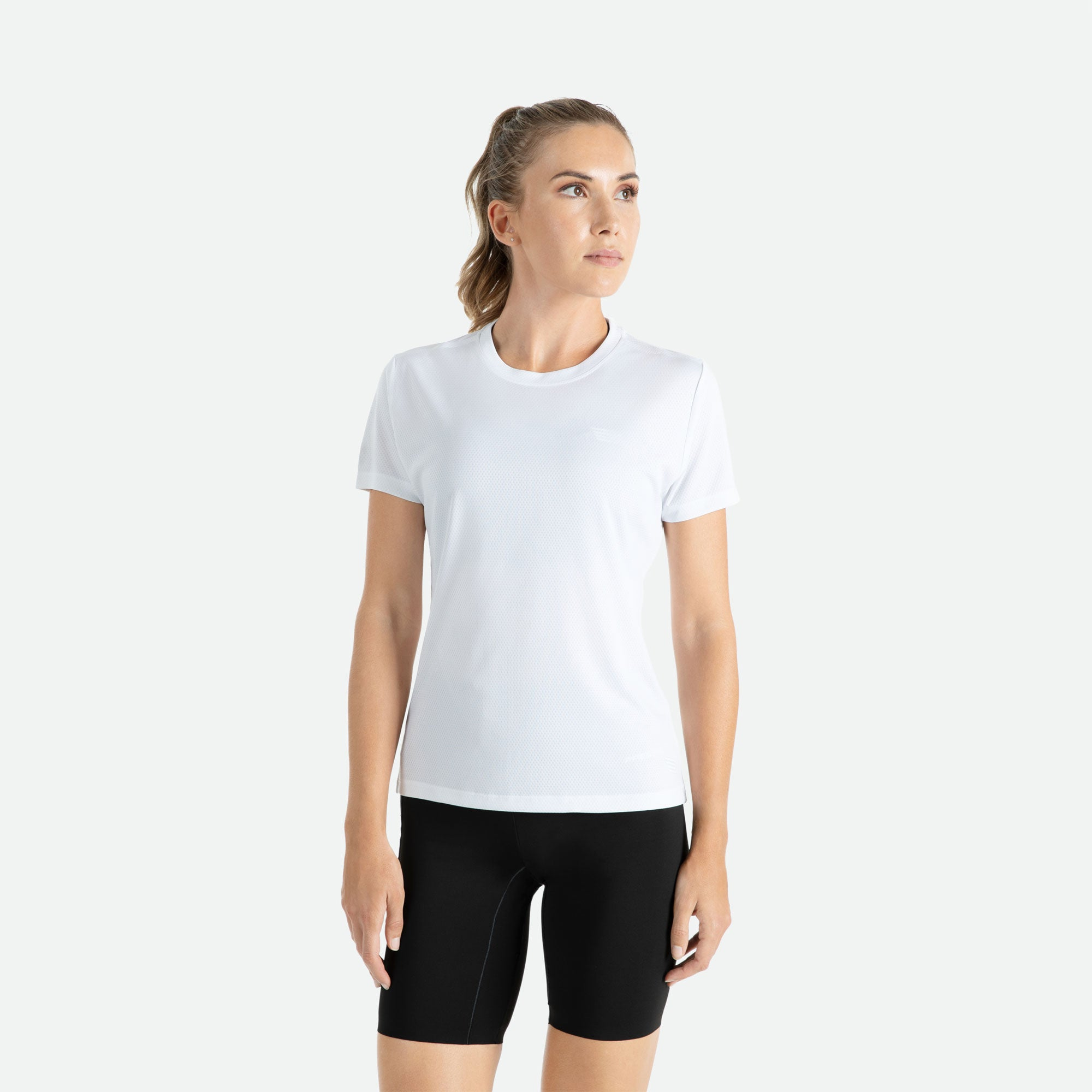 Our Pressio women's white Hāpai short sleeve t-shirt features EcoTECH MF fabric which has dual filament recycled polyester yarns from Unifi for superior moisture control to keep you dry.