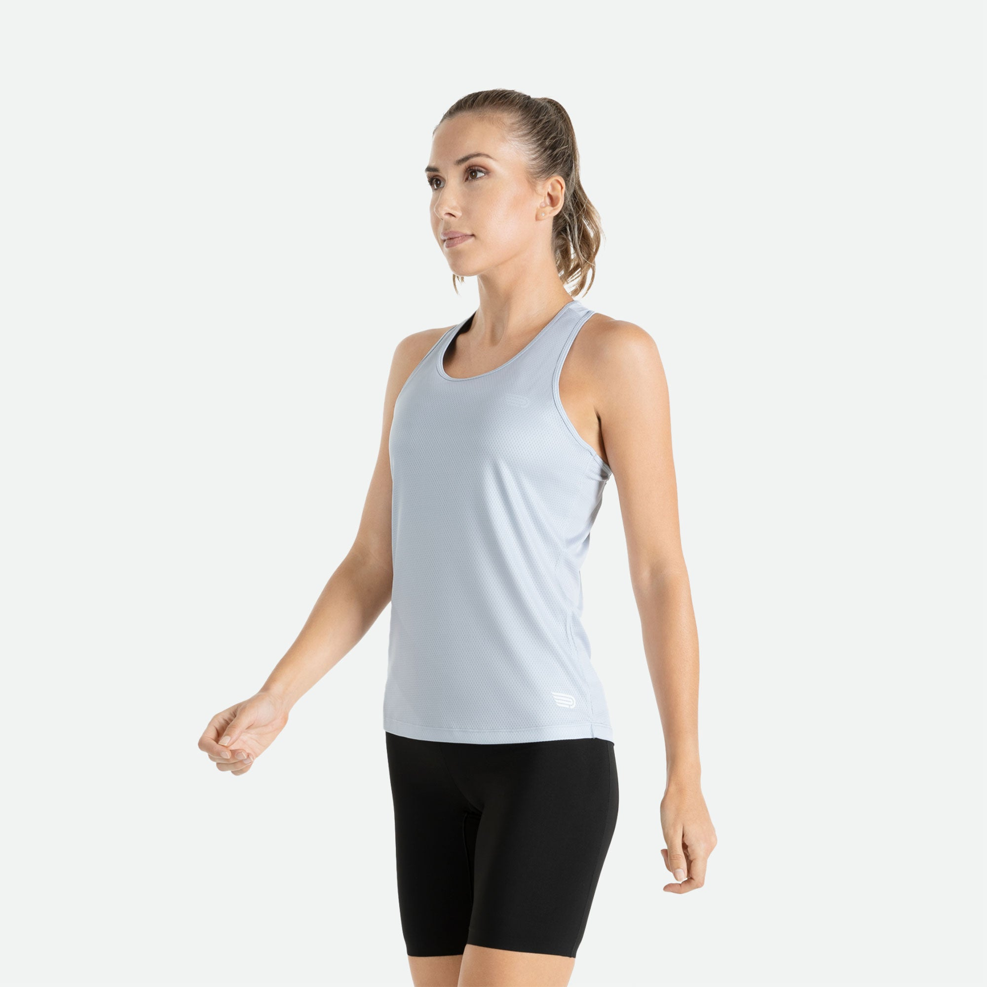 Our Pressio women's light grey Hāpai razorback singlet features EcoTECH MF fabric which has dual filament recycled polyester yarns from Unifi for superior moisture control to keep you dry.