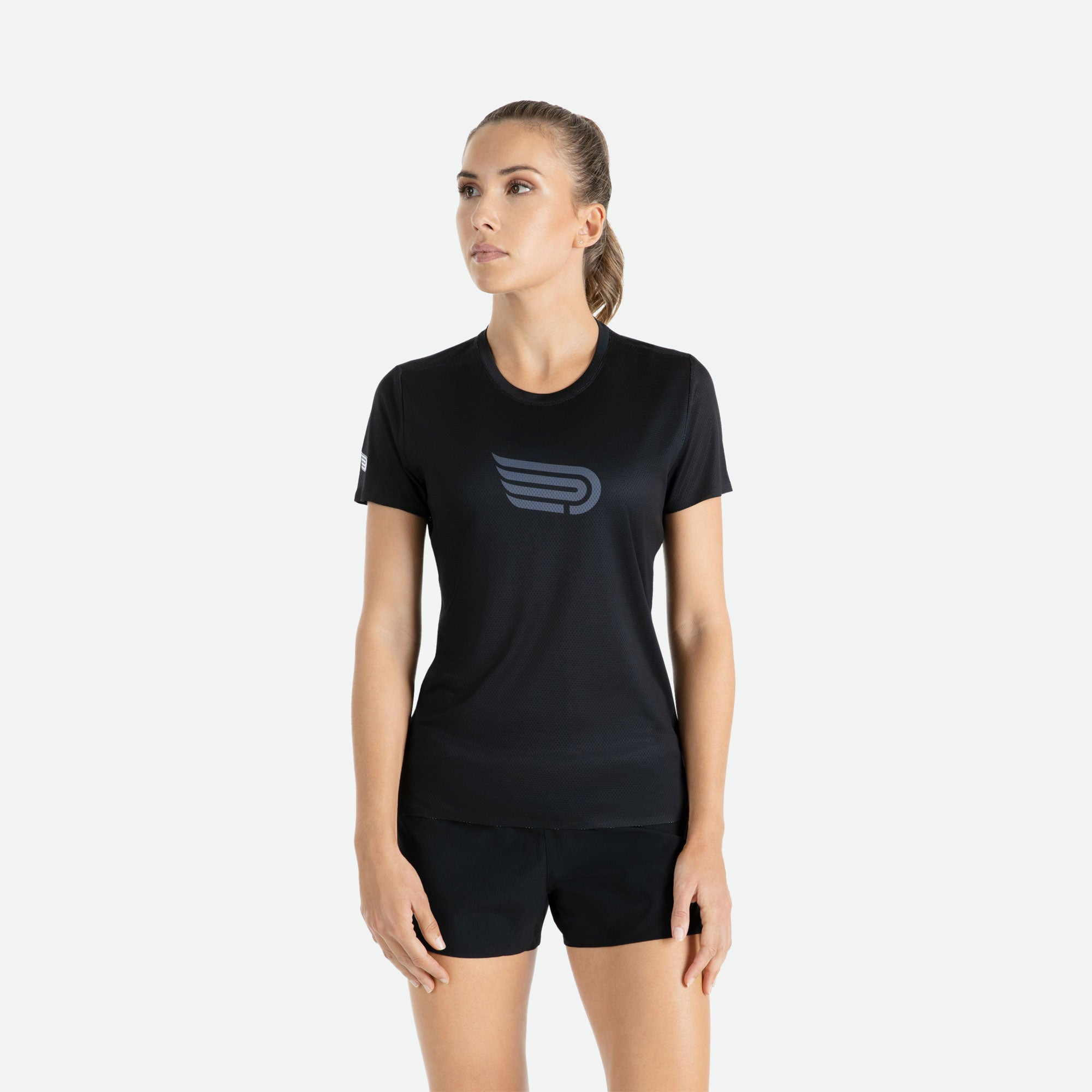 Our Pressio women's Ārahi black/dark grey short sleeve t-shirt features EcoTECH MF fabric which has dual filament recycled polyester yarns from Unifi for superior moisture control to keep you dry.