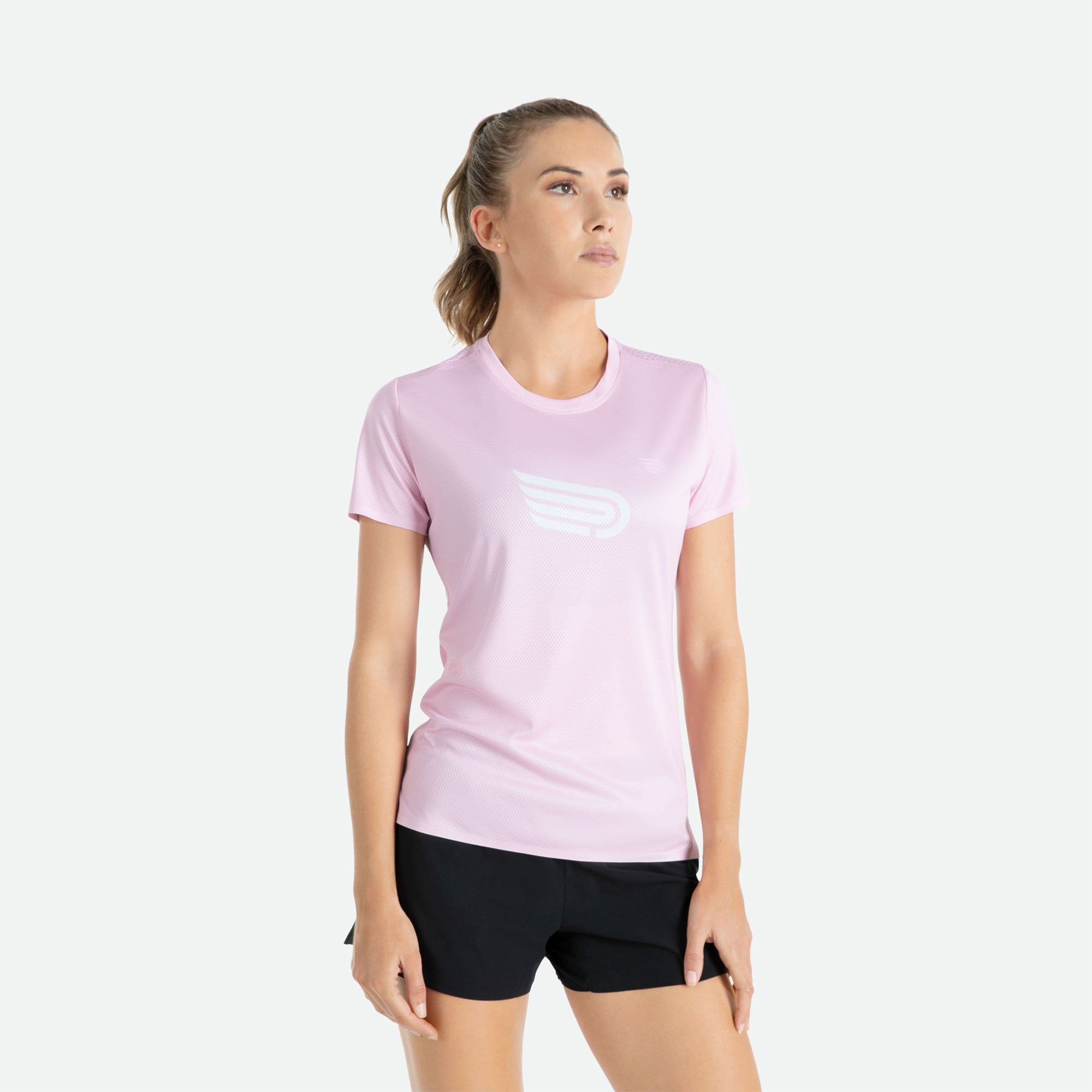 Short sleeve t-shirt women's Pressio Ārahi pink/white constructed of high filament mechanical knit fabric for unrestricted freedom of movement, enhanced comfort, and optimal hand feel.