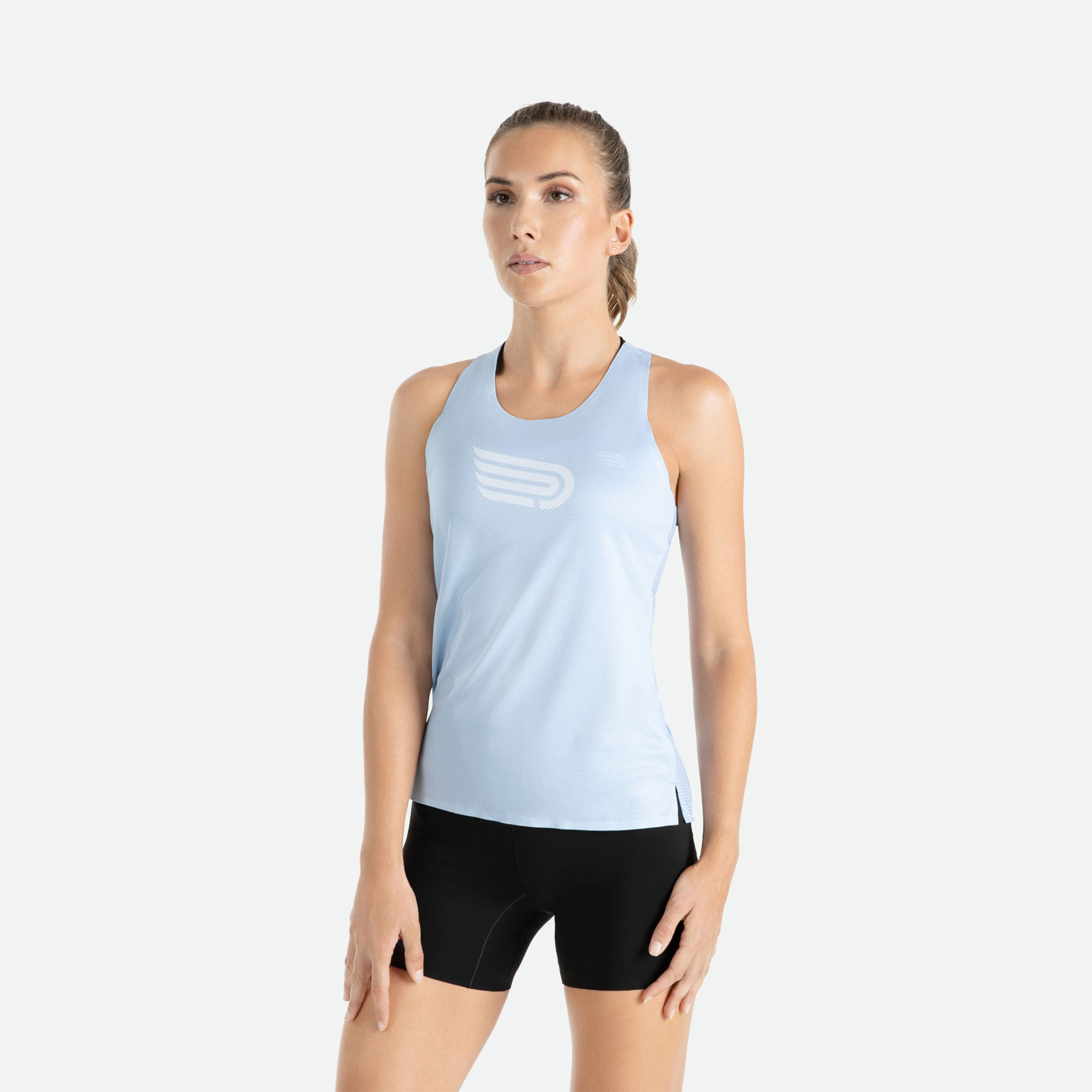 Engineered 3D vent mesh structure for optimal ventilation on the back of our Pressio women's Ārahi light blue/white singlet.
