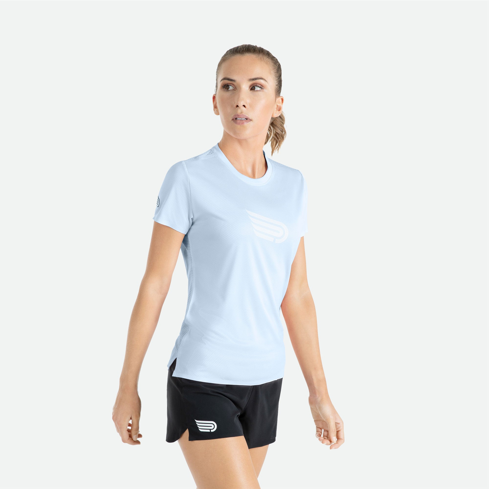 Engineered 3D vent mesh structure for optimal ventilation on the back of our Pressio women's Ārahi light blue/white short sleeve t-shirt.