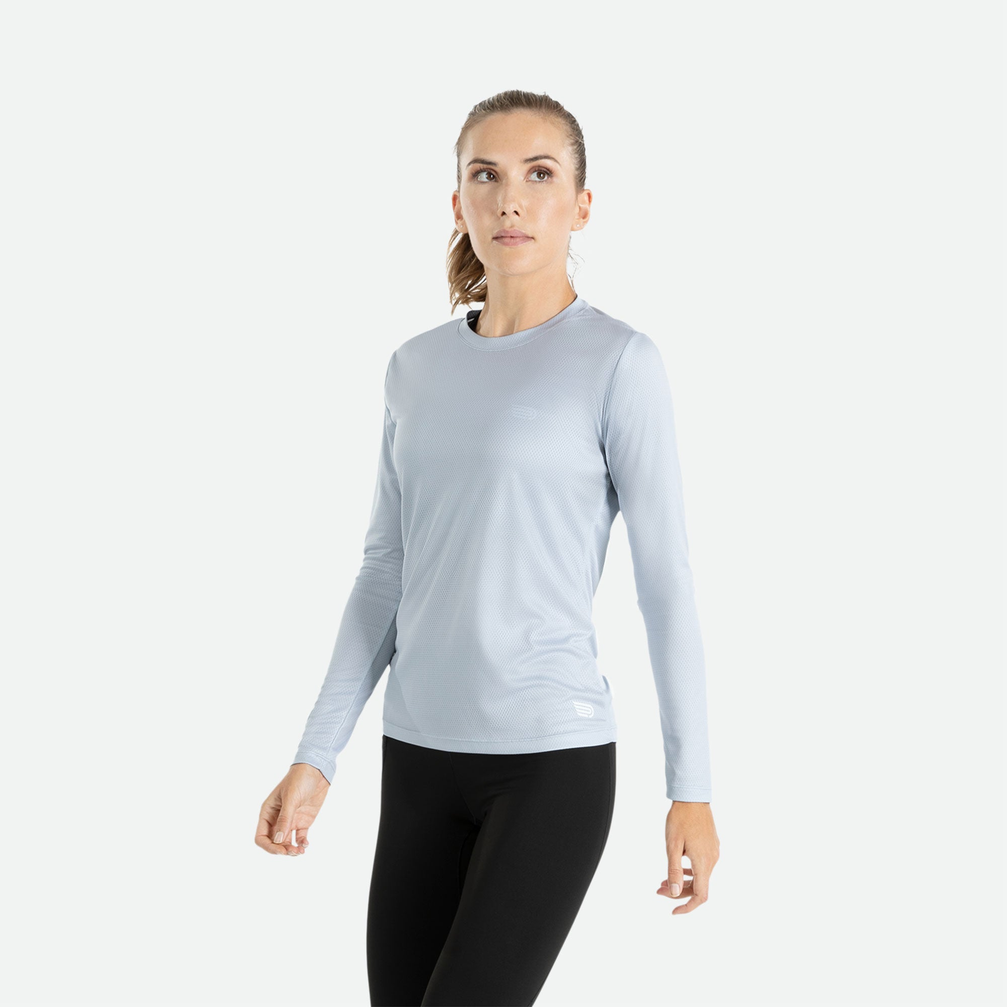Our Pressio women's light grey Hāpai long sleeve t-shirt features EcoTECH MF fabric which has dual filament recycled polyester yarns from Unifi for superior moisture control to keep you dry.