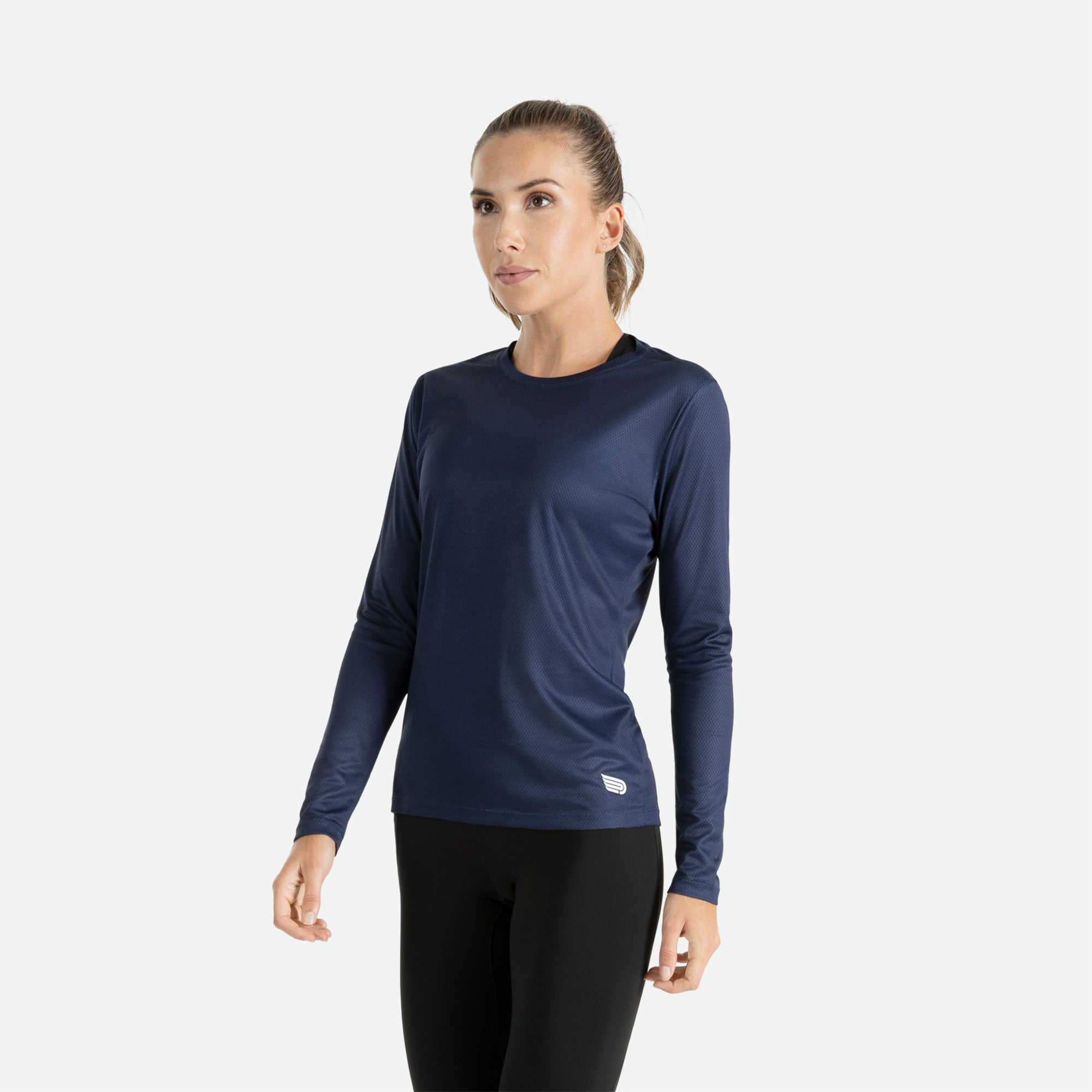 Our Pressio women's navy Hāpai long sleeve t-shirt features EcoTECH MF fabric which has dual filament recycled polyester yarns from Unifi for superior moisture control to keep you dry.