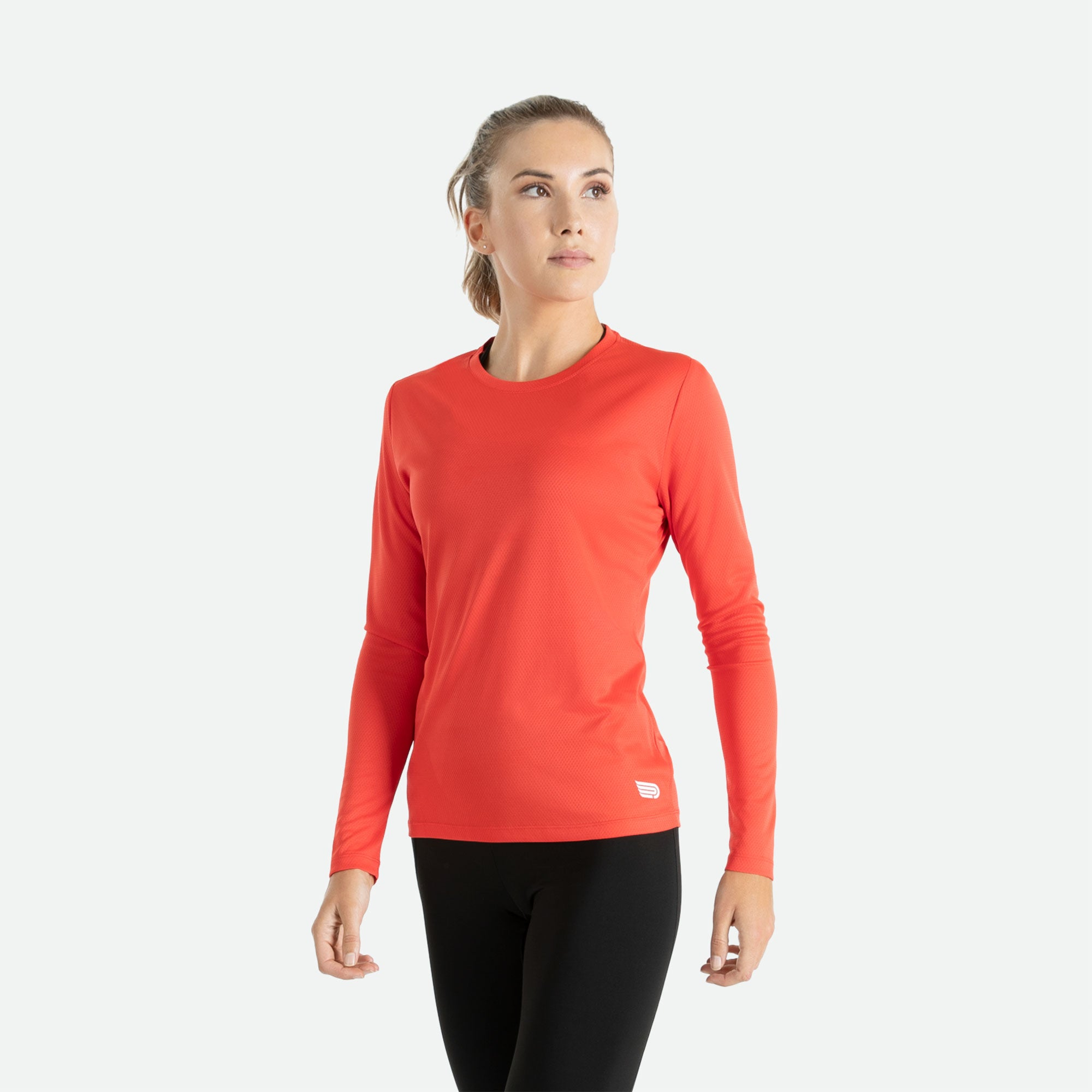 Our Pressio women's red Hāpai long sleeve t-shirt features EcoTECH MF fabric which has dual filament recycled polyester yarns from Unifi for superior moisture control to keep you dry.