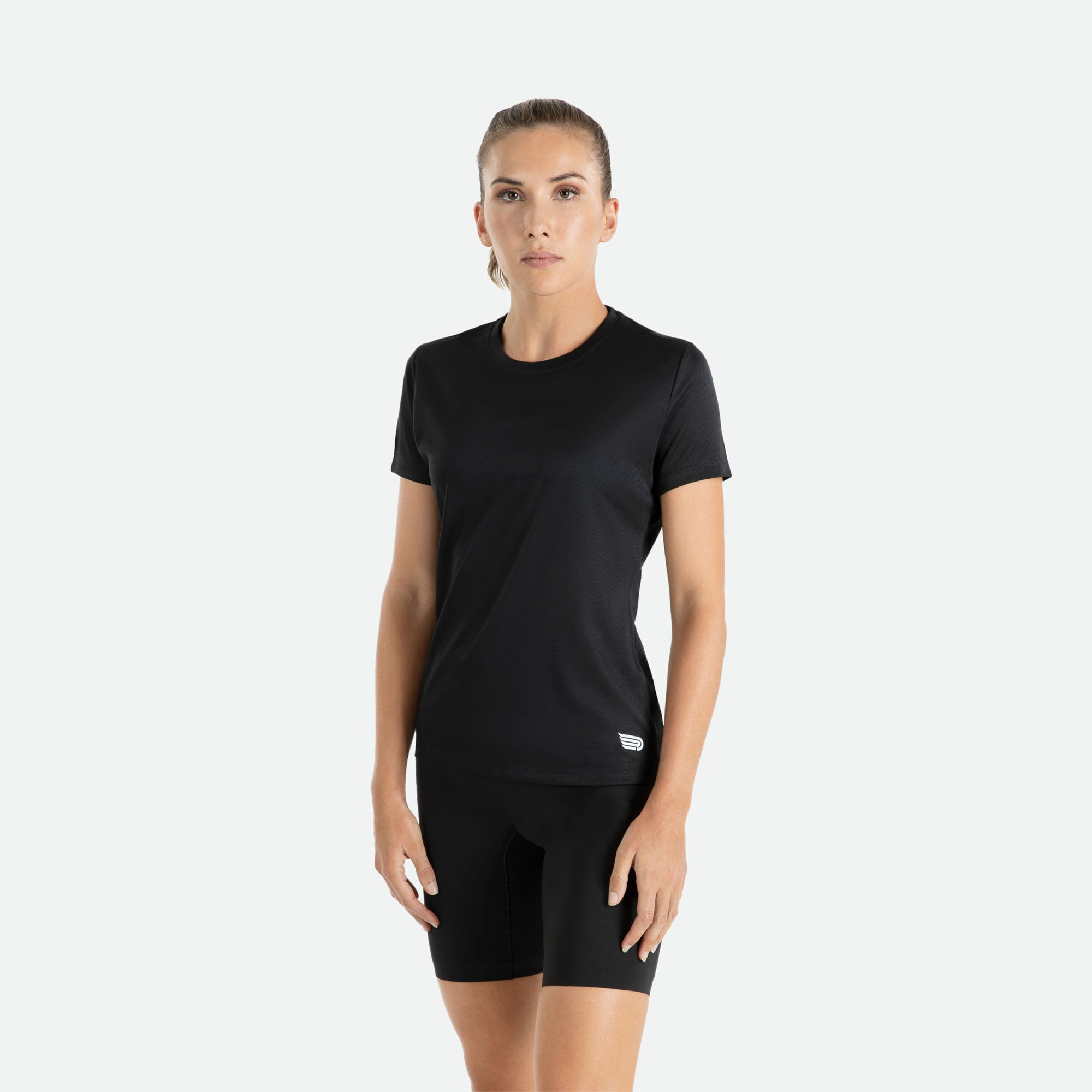 Our Pressio women's black Hāpai short sleeve t-shirt features EcoTECH MF fabric which has dual filament recycled polyester yarns from Unifi for superior moisture control to keep you dry.