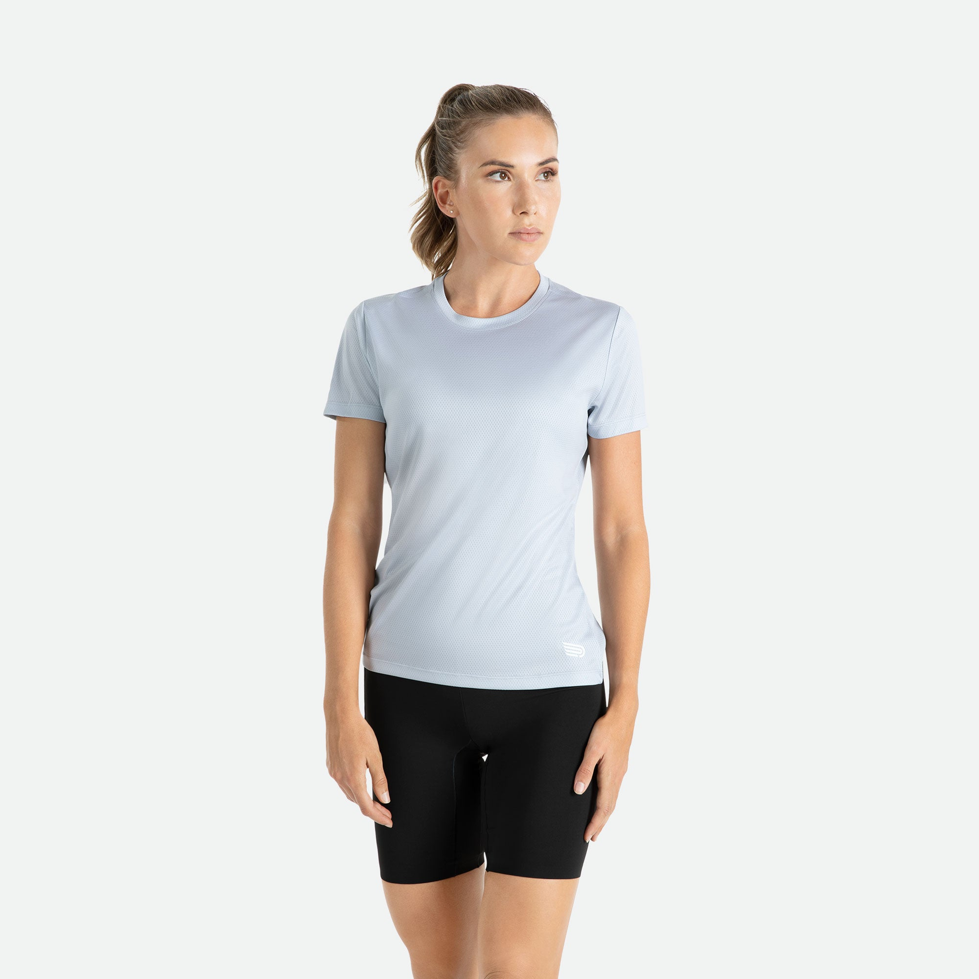 Our Pressio women's light grey Hāpai short sleeve t-shirt features EcoTECH MF fabric which has dual filament recycled polyester yarns from Unifi for superior moisture control to keep you dry.