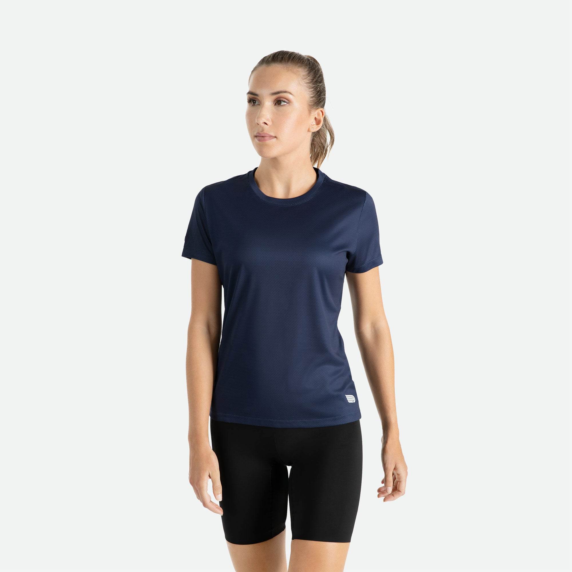 Our Pressio women's navy Hāpai short sleeve t-shirt features EcoTECH MF fabric which has dual filament recycled polyester yarns from Unifi for superior moisture control to keep you dry.