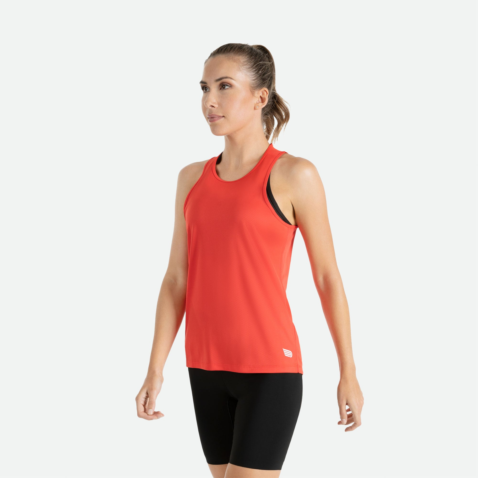 Our Pressio women's red Hāpai wideback singlet features EcoTECH MF fabric which has dual filament recycled polyester yarns from Unifi for superior moisture control to keep you dry.