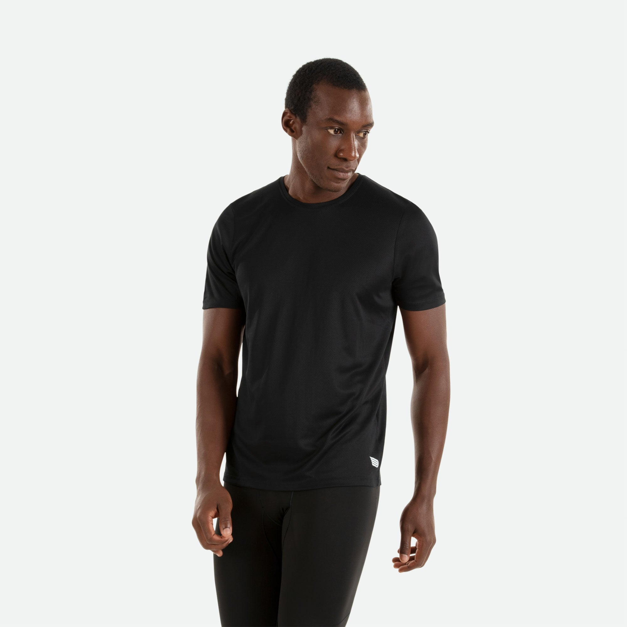 Our Pressio men's black Hāpai short sleeve t-shirt features EcoTECH MF fabric which has dual filament recycled polyester yarns from Unifi for superior moisture control to keep you dry.