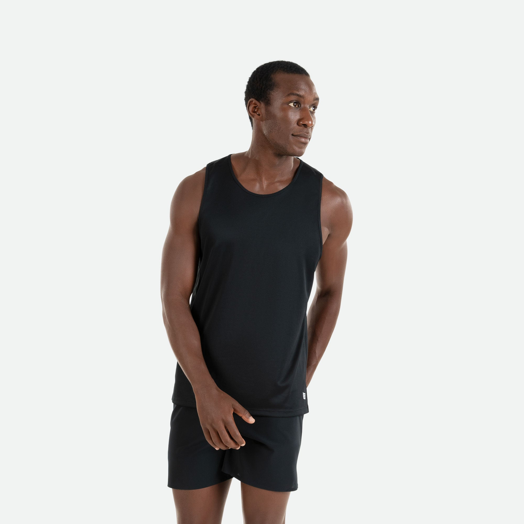 Our Pressio men's black Hāpai singlet features EcoTECH MF fabric which has dual filament recycled polyester yarns from Unifi for superior moisture control to keep you dry.