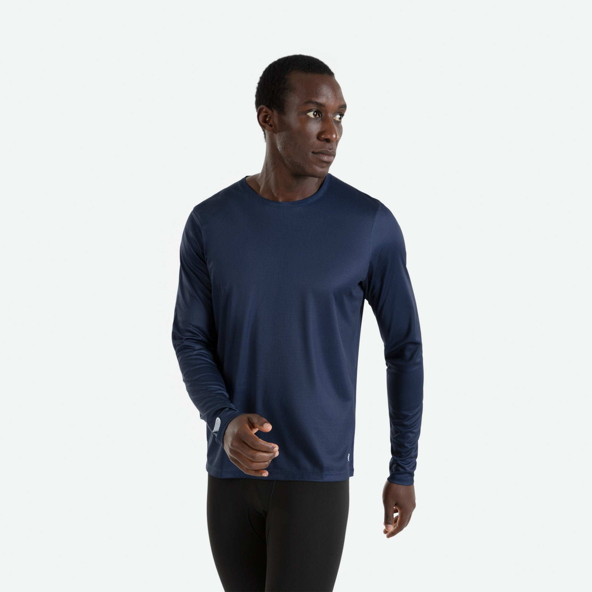 Our Pressio men's navy Hāpai long sleeve t-shirt features EcoTECH MF fabric which has dual filament recycled polyester yarns from Unifi for superior moisture control to keep you dry.