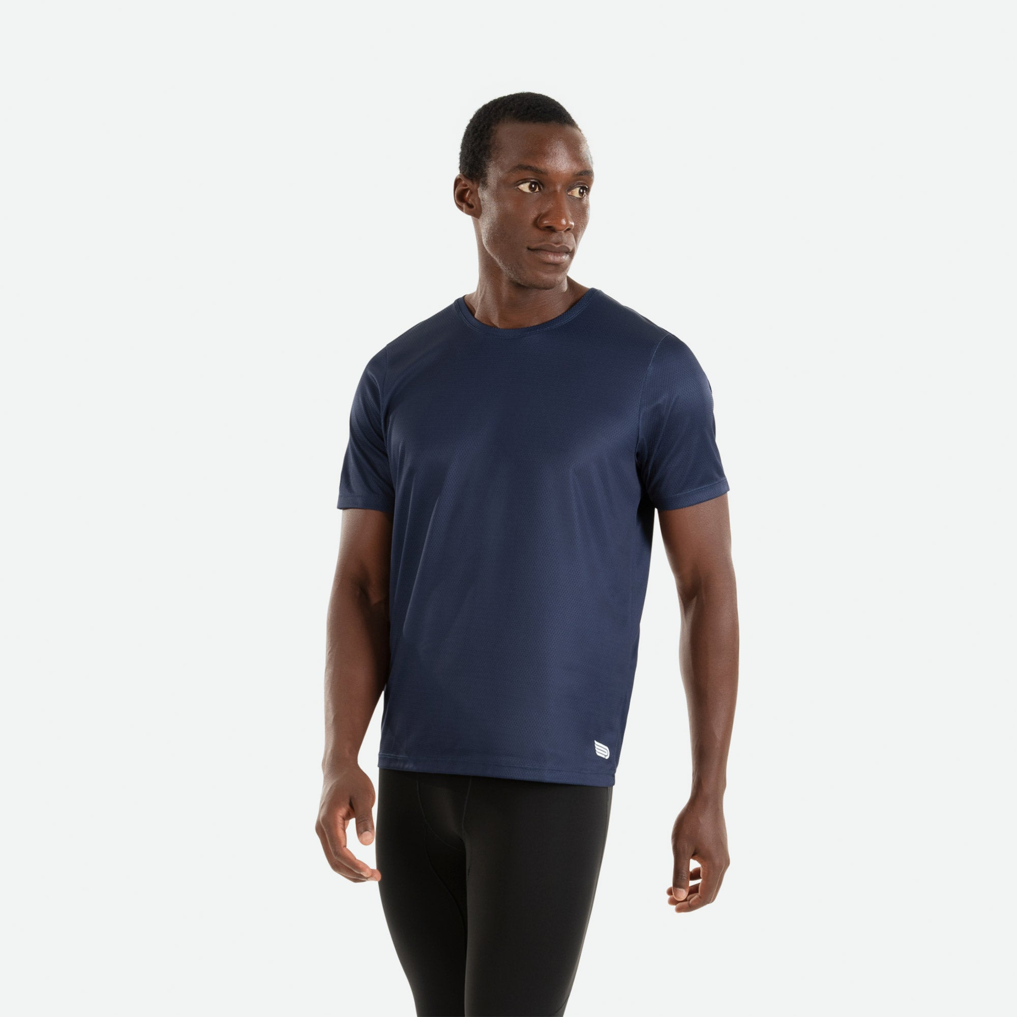 Our Pressio men's navy Hāpai short sleeve t-shirt features EcoTECH MF fabric which has dual filament recycled polyester yarns from Unifi for superior moisture control to keep you dry.